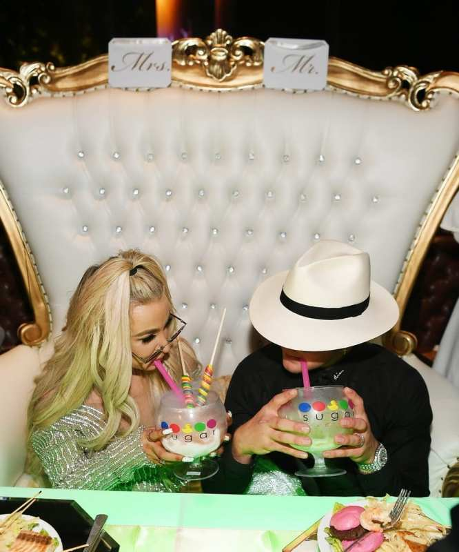 Newlyweds enjoy signature lollipop passion and watermelon patch Sugar Factory goblets.