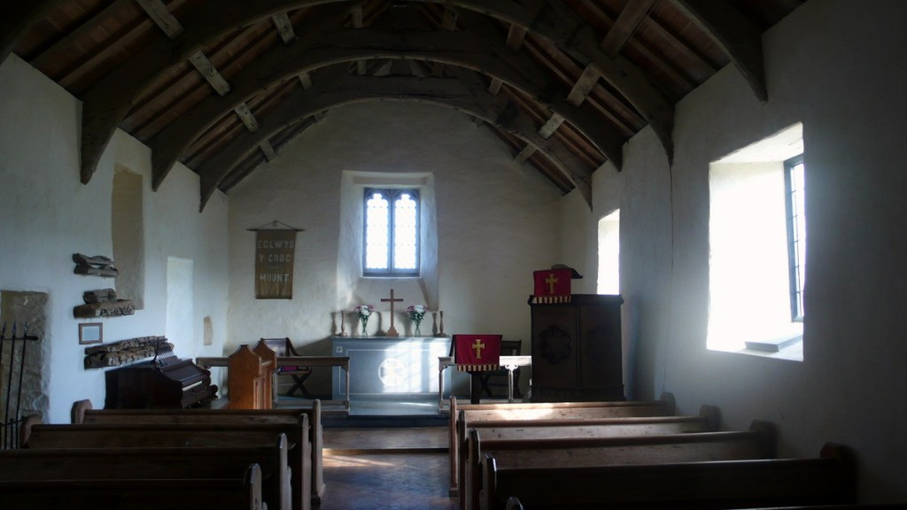 The Interior of the 14th Century parish church at Mwnt, Ceredigion, from a travel blog by traveljunkiegirl.com