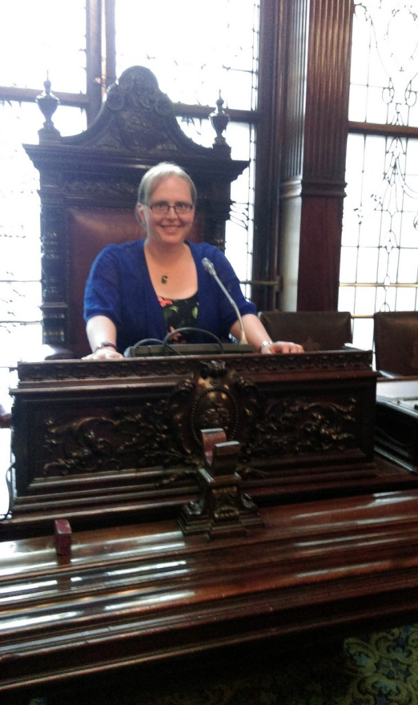 Sat in the Lord Provost's Chair in the council chamber at Glasgow's City Chambers building; from a travel blog by www.traveljunkiegirl.com