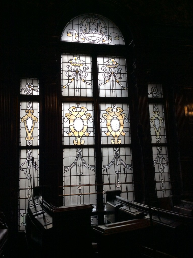 The window in Glasgow's council chamber in the City Chambers building; from a travel blog by www.traveljunkiegirl.com