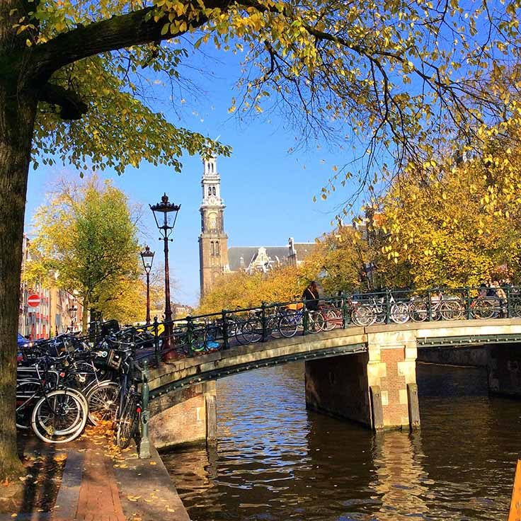 Autumn on the Prinsengracht Canal in Amsterdam; from a travel blog by www.traveljunkiegirl.com