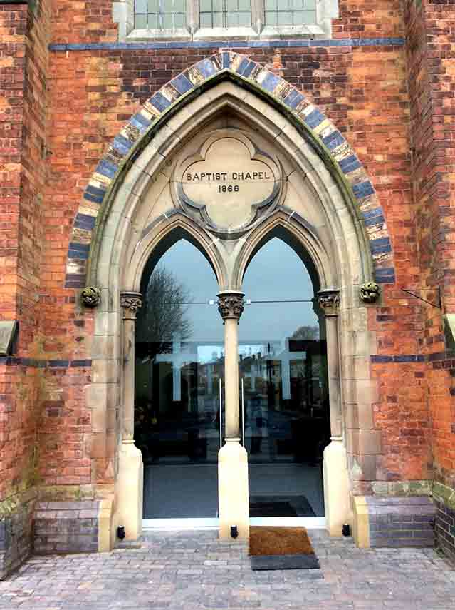 Entrance to Tarporley's Baptist Church, Cheshire; from a travel blog by www.traveljunkiegirl.com