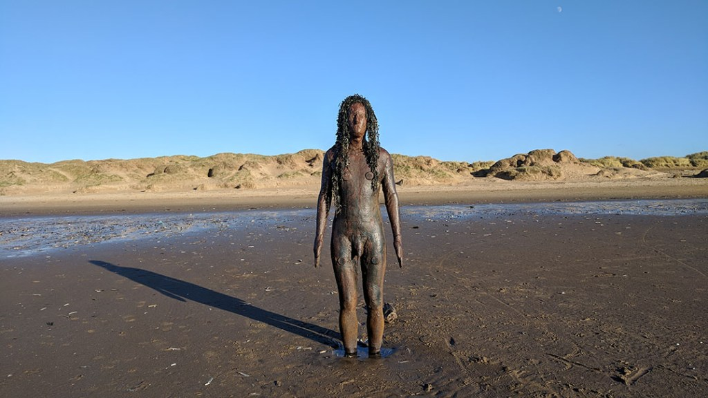 Anthony Gormley's 'Another Place' Iron Men at Crosby Beach, Merseyside; from a travel blog by www.traveljunkiegirl.com