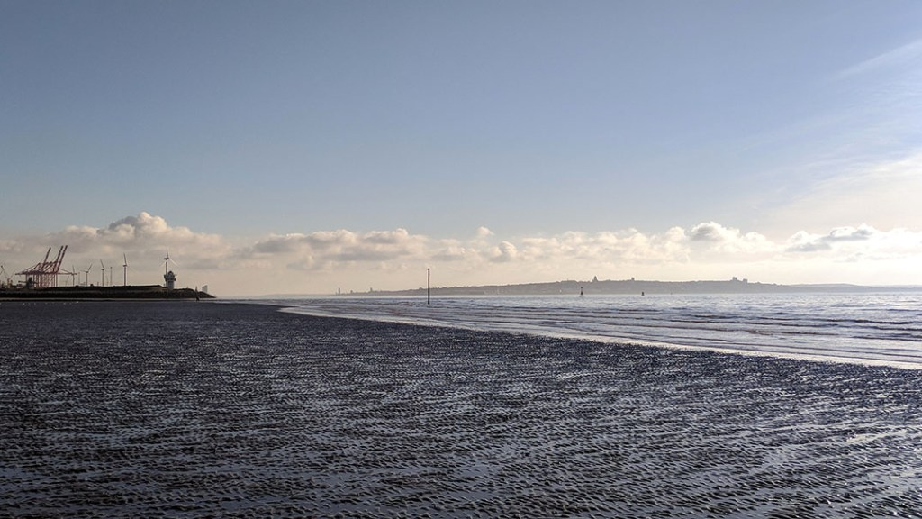 View from Crosby Beach, Merseyside looking down the mouth of the River Mersey with the Wirral Peninsula beyond; from a travel blog by www.traveljunkiegirl.com