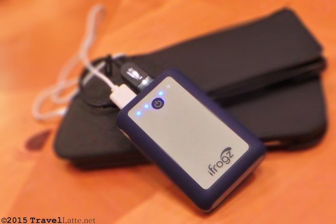 Photo: Smartphone, tablet, and iFrogz 7800 battery-powered charger.