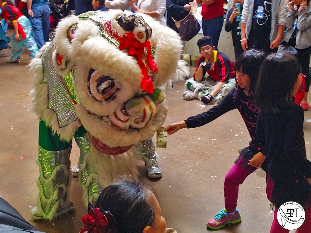 Tet in Texas: Chinese New Year at Asia Time Square_Feeding the Lion via @TravelLatte.net