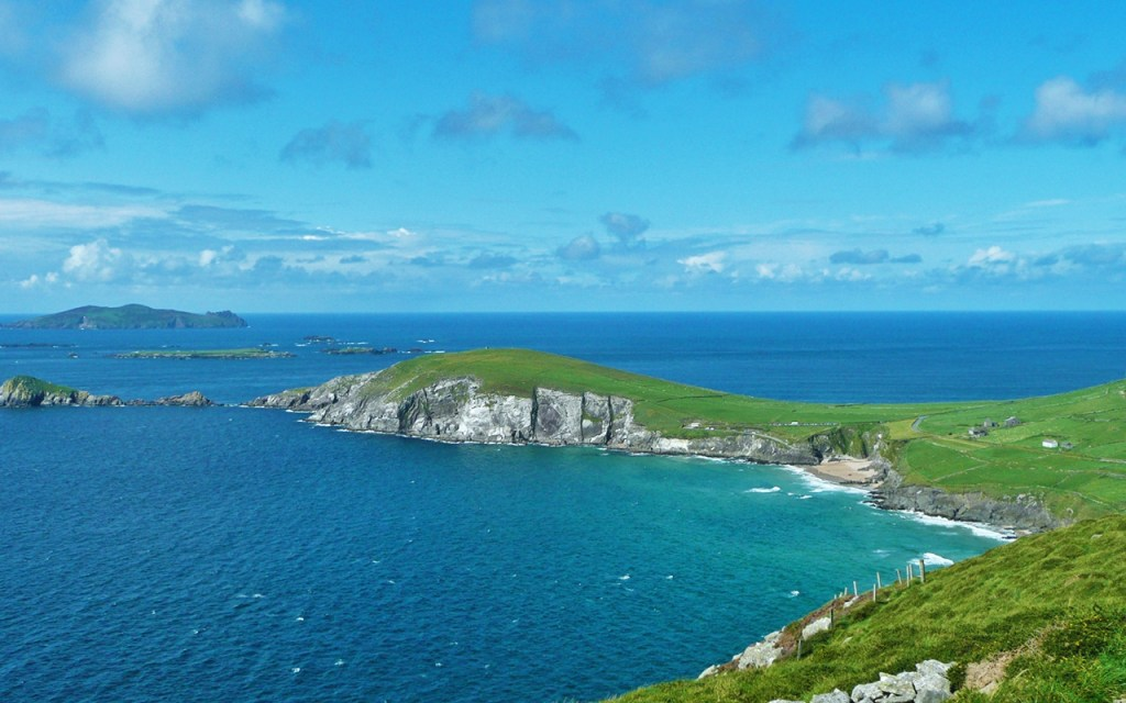 View of Slea Head Beach, Dunmore Head & Blasket Islands on Ireland's Scenic Slea Head Drive via @TravelLatte.net