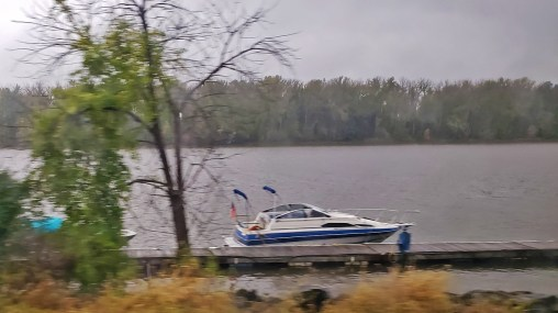A boat moored along the Hudson River, seen from the Amtrak Adirondack, by TravelLatte.