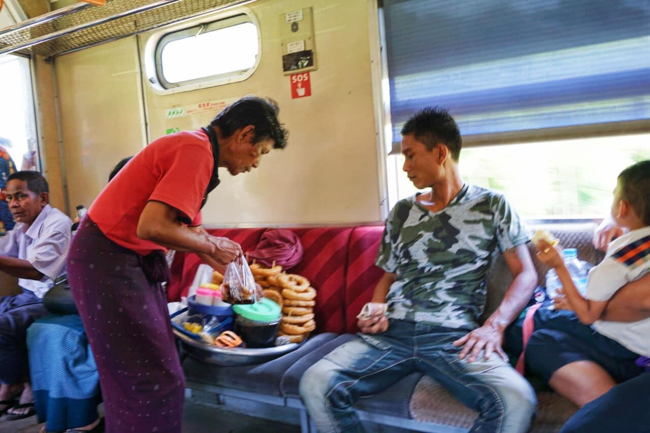 Myanmar photos vendor on Yangon circle line