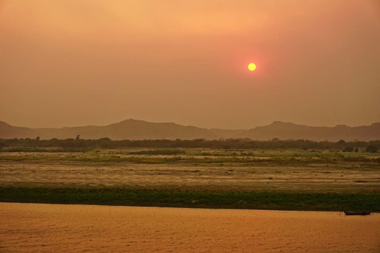 Myanmar photos sunset over river in Bagan