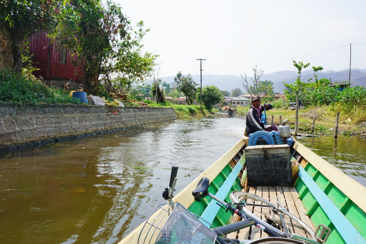 Myanmar photos bike in boat on Lake Inle Burma