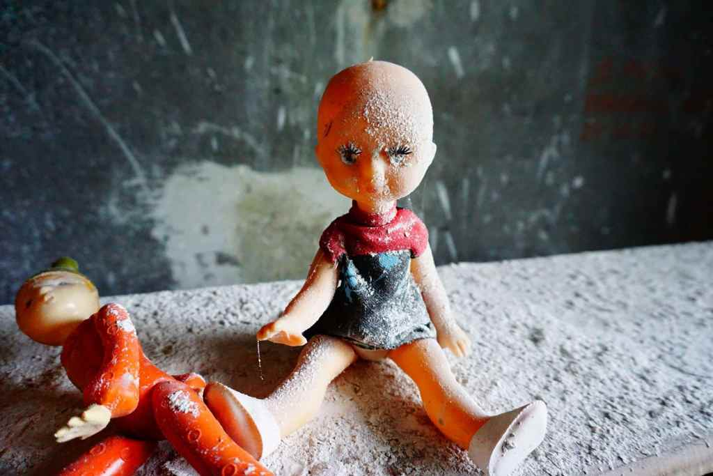 Chernobyl pictures: doll covered in dust
