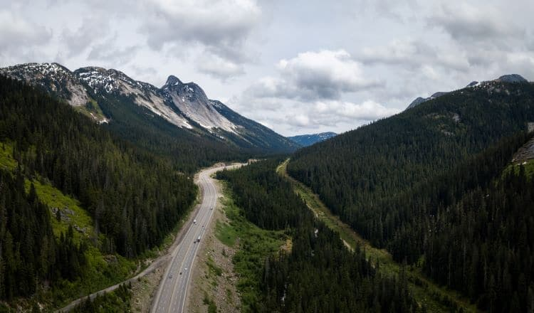 Aerial view of the scenic route passing in the valley between the mountains. Taken in Coquihalla Hwy Northeast from Hope, British Columbia, Canada.