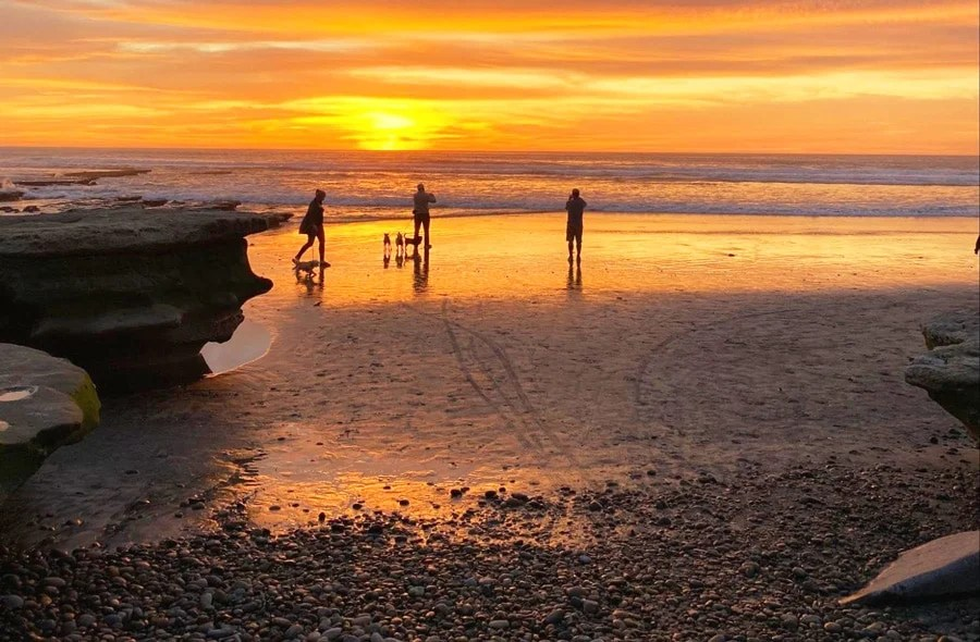 View of people admiring the sunset in La Jolla Beach