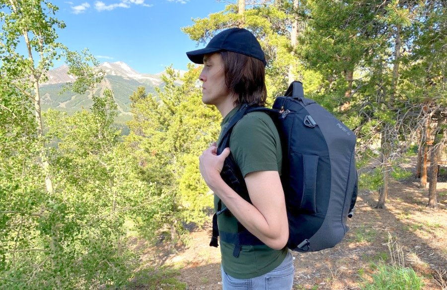 The author standing to the side modeling the Osprey backpack