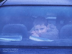 Boy watching me from the car window