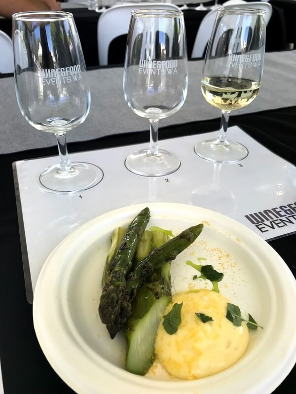 glass-of-hitton-triptych-chardonnay-white-plate-with-asparagus-sabayon-cured-egg-yolk-and-pepper-berry