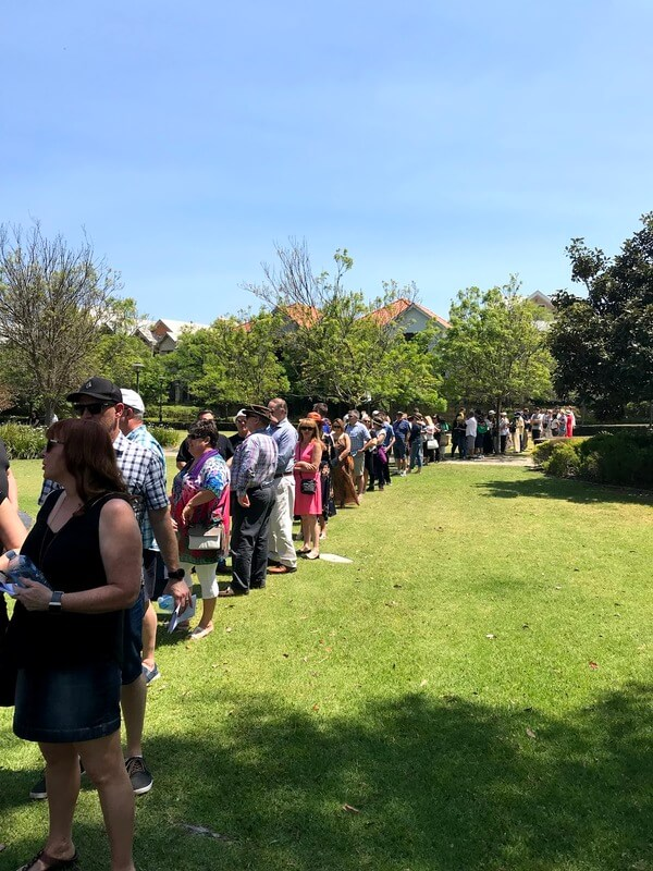 line-of-people-standing-on-grass-at-unwined-subiaco