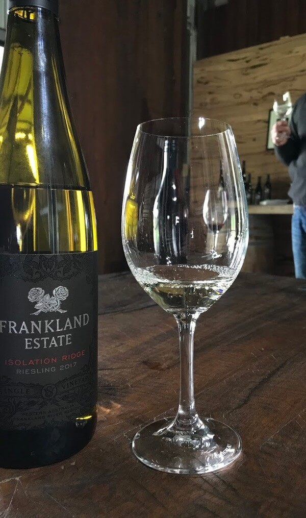 bottle-and-glass-of-frankland-estate-isolation-ridge-riesling-in-frankland-river-great-southern