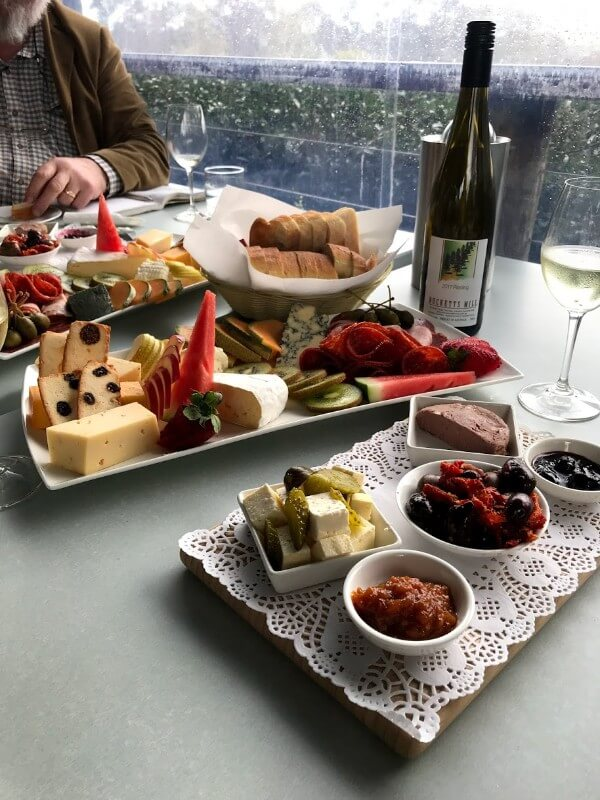 bottle-and-glass-of-late-harvest-riesling-and-platters-full-of-fruit-cheese-and-meat