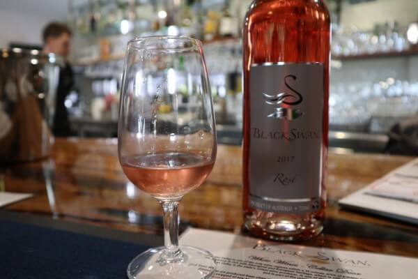 glass-and-bottle-of-rose-at-black-swan-winery-swan-valley