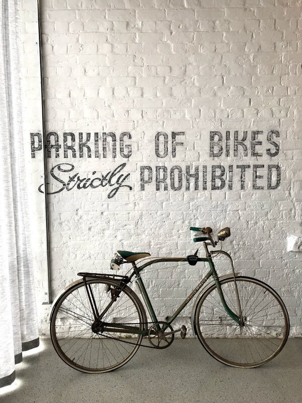 parking-is-strictly-prohibited-sign-on-white-wall-and-old-bicycle-at-the-premier-mill-hotel-katanning
