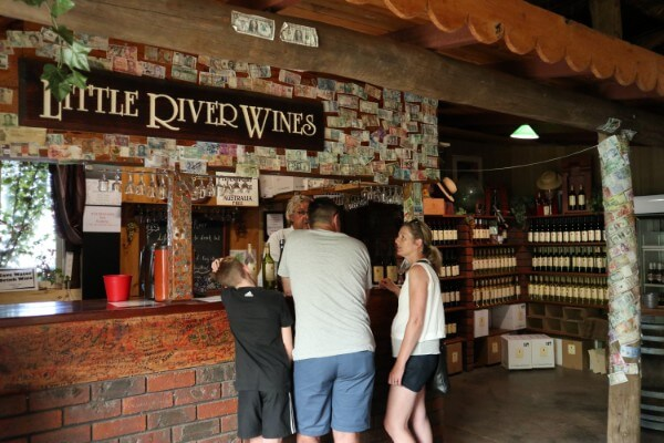 three-people-standing-at-the-cellar-door-served-wines
