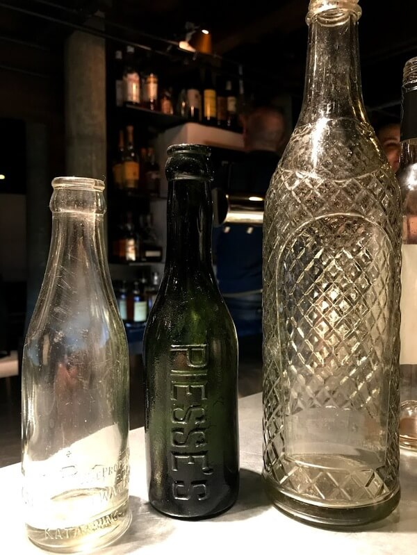 three-piesse-cordial-bottles-in-clear-and-green-in-the-cordial-bar-at-the-premier-mill-hotel-katanning