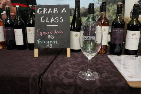 blackboard sign with grab a glass sppok rock or talisman wine at city wine yagan square perth