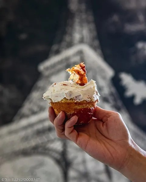 Holding a Cheesecake in a Blanket with Eiffel Tower backdrop