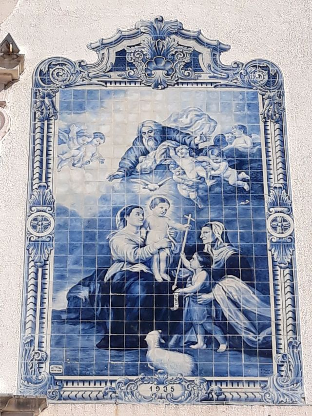 A mosaic made of tiles on the facade of a church in Aveiro in Portugal