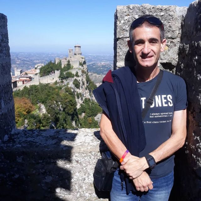Me with view of castle in San Marino in the background