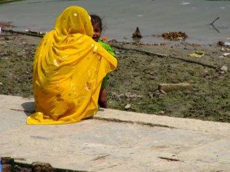 varanasi woman and child at water