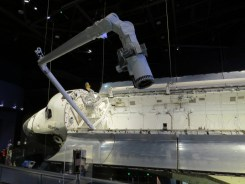 Atlantis' last mission was to release a satellite. a replica of the satellite is in the lower part of the photo - tiny!!