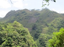 Deforestation is obvious and extreme. Hill slopes and tops cleared for crops and plantations