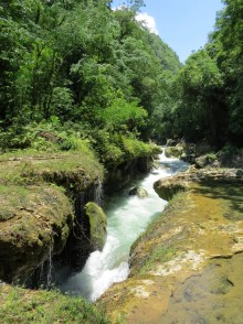 The river going below the limestone formation