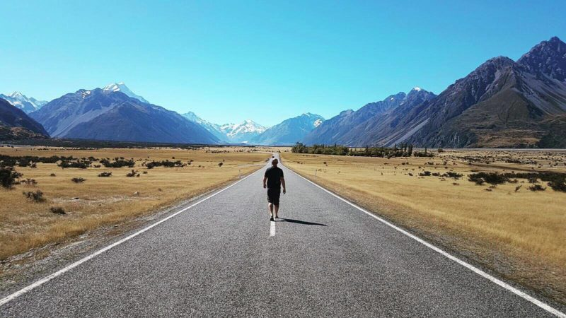 New Zealand road walking landscape mountains view travel shadow thinking journey