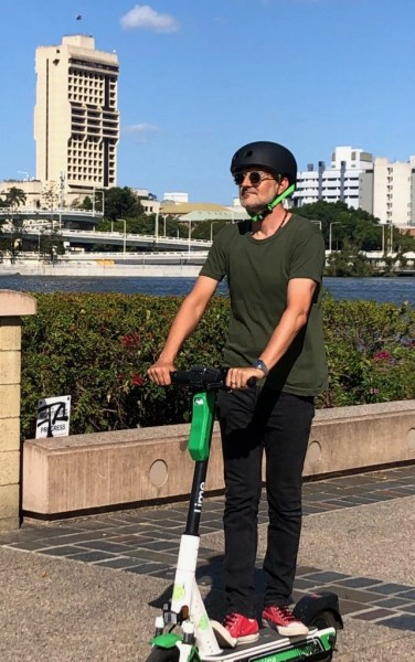 gionny riding a lime scooter in Brisbane