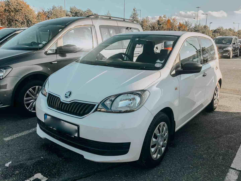 Travel Tips - White car in a car park