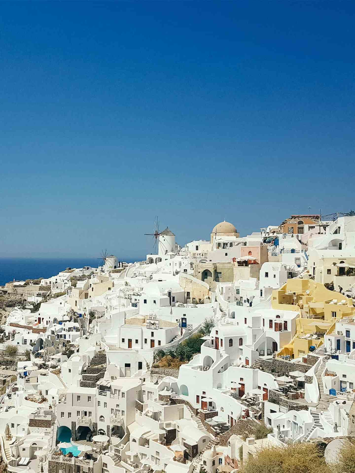 White buildings in Greece against a blue sky
