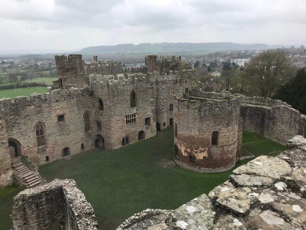 View of Ludlow castle ruins from the top