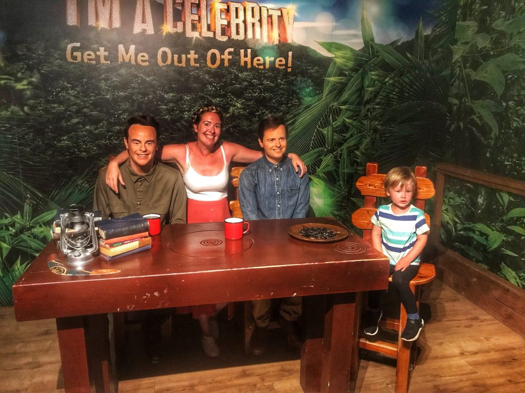 Nicola and Dexter sat with wax figures Ant and Dec at Madame Tussauds Blackpool