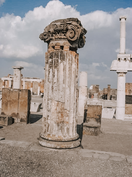 A ruined column at the forum in Pompeii