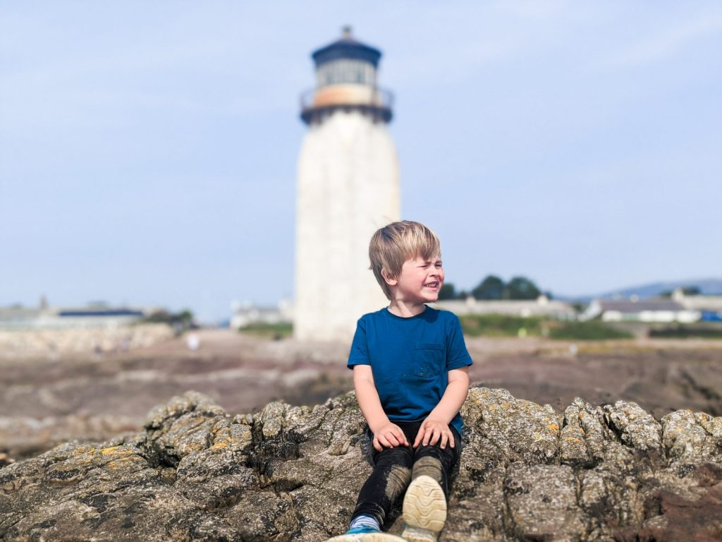 Dexter posing in front of Southerness lighthouse