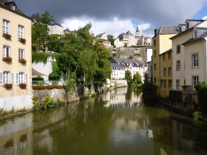 Lovely houses, trees and flowers were reflected on the calm water in Grund in Luxembourg