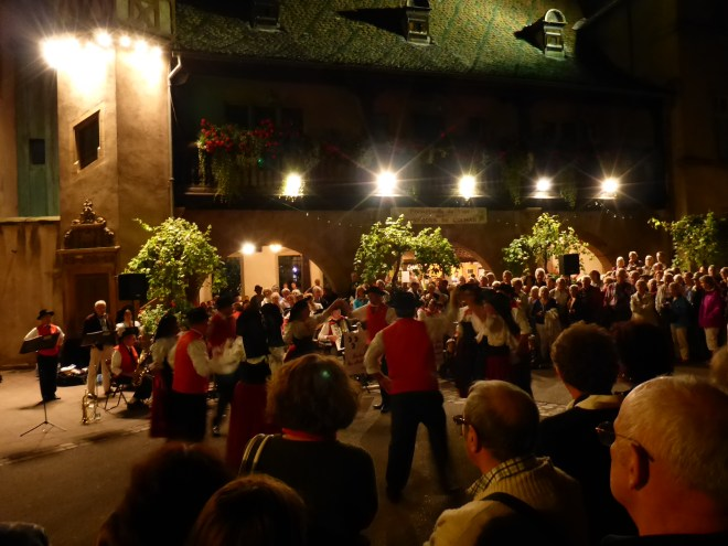 Weekly folklore music and dancing in the street in Colmar