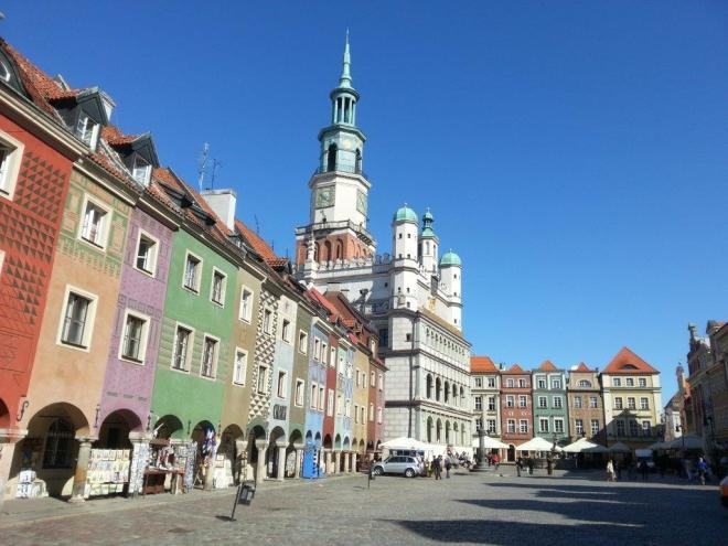 Craftmen houses and the high raised renaissance Town Hall in Poznan market square