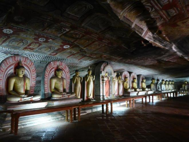 Buddha statues and murals in the Rock Temple of Dambulla 3