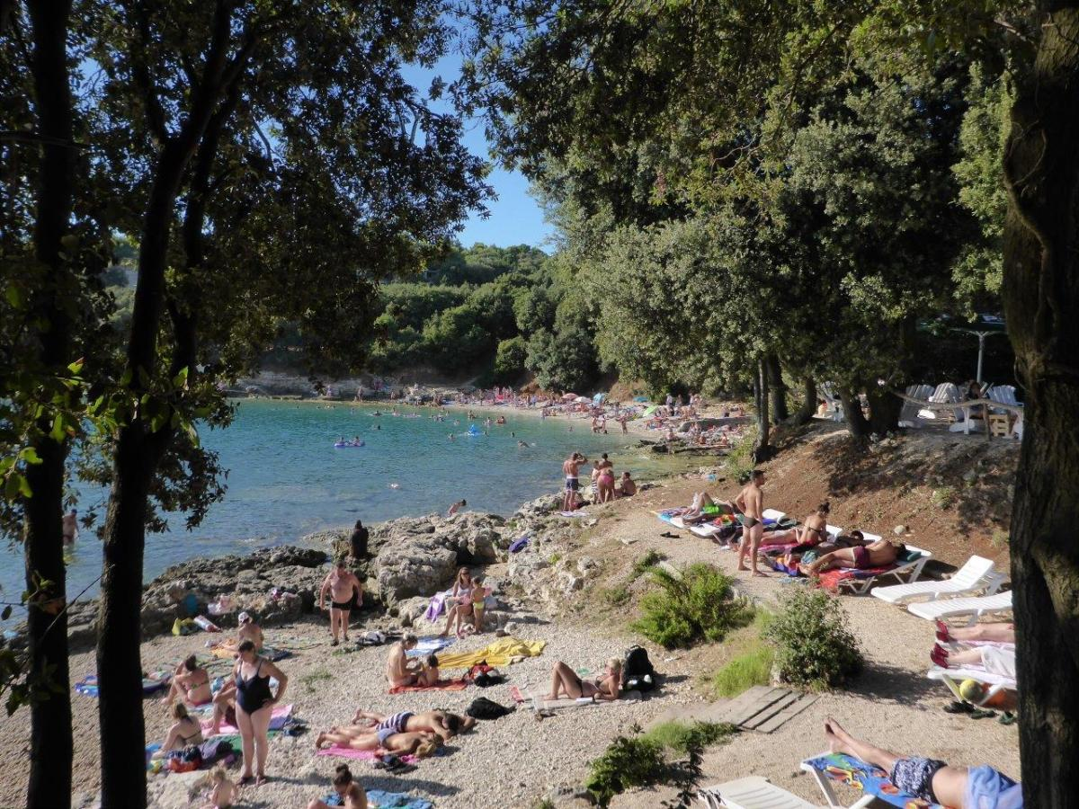 Overcrowded Verudella beach in Pula, Croatia