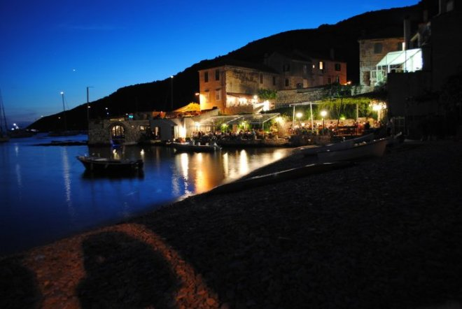 The harbor in Komiza by night. Vis island, Croatia